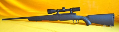 Savage Axis 25.06 bolt rifle with Weaver scope/ like new!